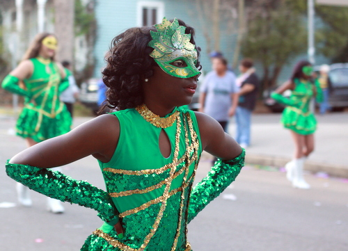 A dancer from Samuel J. Green Charter School marches in the Mystic Krewe of Femme Fatales parade. (Robert Morris, UptownMessenger.com)