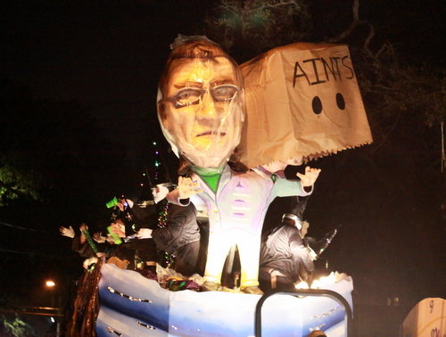 "The first of the Mystic Krewe of Druids' dilemma floats asks, ""Paper or Plastic?"" (Robert Morris, UptownMessenger.com)"
