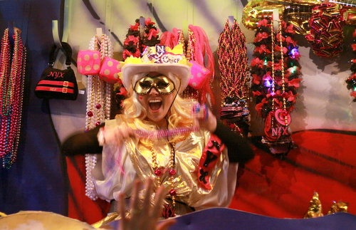 A rider in the Mystic Krewe of Nyx displays throws to the Magazine Street crowd. (Robert Morris, UptownMessenger.com)