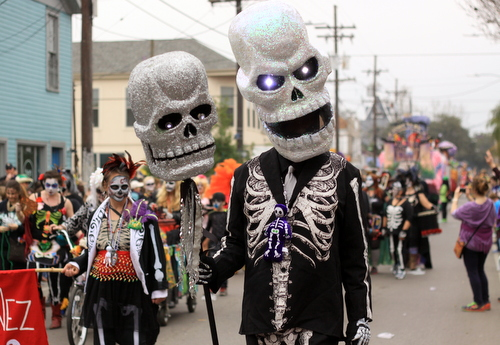 The Skinz and Bonez gang marches on Magazine Street with the Krewe of Okeanos. (Robert Morris, UptownMessenger.com)