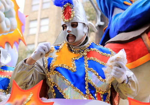 A Rex rider throws beads on St. Charles Avenue. (Robert Morris, UptownMessenger.com)
