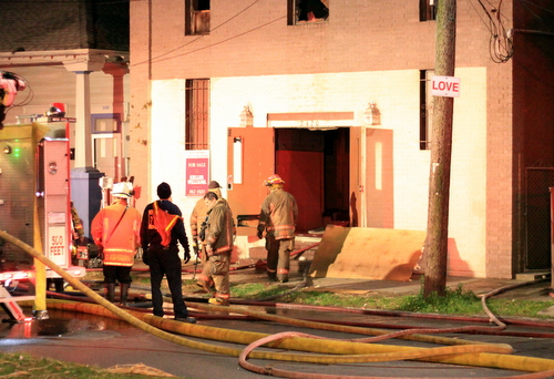 Firefighters look for hotspots after a blaze at 2420 Martin Luther King Boulevard. (Robert Morris, UptownMessenger.com)
