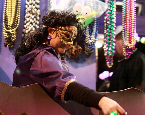 A rider on the Krewe of Cleopatra's Skeleton float. (Robert Morris, UptownMessenger.com)