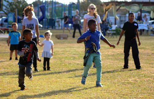 Children play dodgeball during the Freret Get-Together at Evans Park in December. The event was hosted by the Evans Park Booster Club, with activities organized by Eric and Claudean Capers of Anytime Fitness. (Photo by Liz Jurey, courtesy of Freret Neighborhood Center)