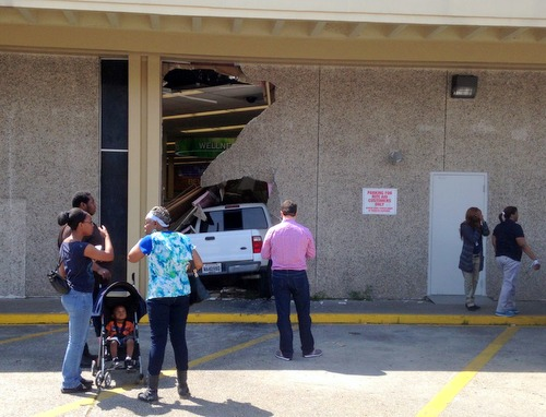 Bystanders examine a truck crashed inot the Rite Aid at 3401 St. Charles Avenue on Monday afternoon. (submitted photo)