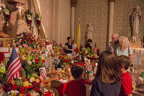 People observe the elaborate altar at St. Stephen's church. (Zach Brien, UptownMessenger.com)