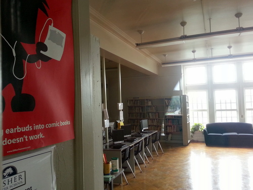 A glimpse inside the Lusher High School library shows bookshelves next to rows of computers, along with posters urging students to keep reading in the technology age. (Robert Morris, UptownMessenger.com)