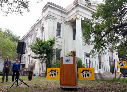 Sandra Stokes of the Louisiana Landmarks Society speaks in front of the Carrollton Courthouse on Wednesday, June 24. (Robert Morris, UptownMessenger.com)