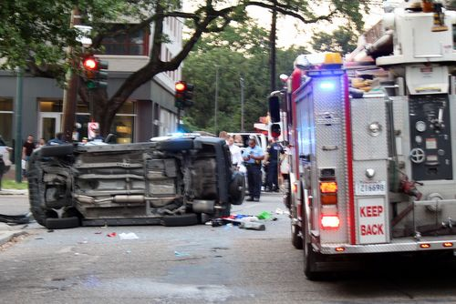 Police investigate the crash of a vehicle Wednesday on St. Charles Avenue, following a police chase after it was taken in a carjacking in Mid-City. (photo via our partners at WWL; click image for full photo gallery)