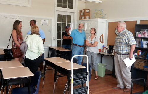 Lusher school operations director Frank Israel (at right) leads members of the school's governing board Saturday morning on a tour of renovations to the Fortier campus. (Robert Morris, UptownMessenger.com)