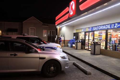 A NOPD vehicle sits outside the Circle K on Magazine Street on Monday evening. (Robert Morris, UptownMessenger.com)