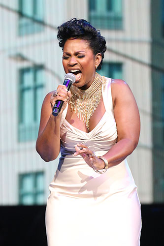 Stephanie Jordan sings during the Katrina 10 commemoration at the Smoothie King Center on Saturday. (Zach Brien, UptownMessenger.com)