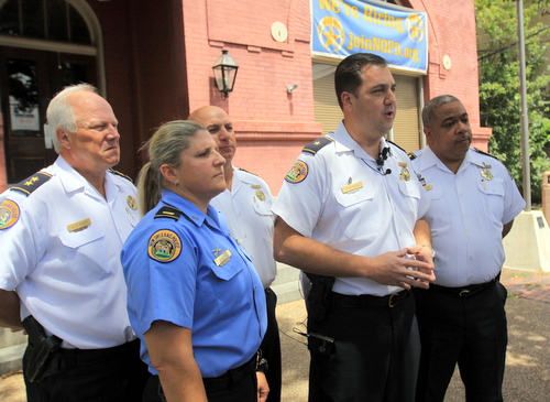 NOPD leadership -- from left, Deputy Chief Bob Bardy, Second District Lt. Jennifer Dupree, Sixth District Commander Ronnie Stevens, Second District Commander Paul Noel, and Chief Michael Harrison -- discuss recent Uptown armed robberies on Tuesday. (Robert Morris, UptownMessenger.com)