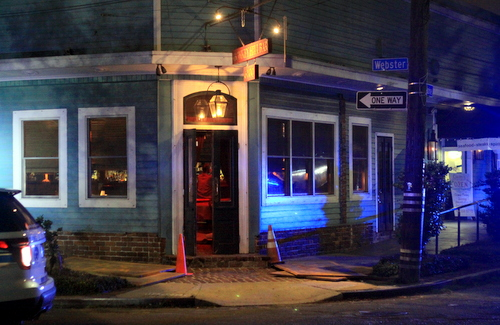 Police vehicles sit outside Monkey Hill bar on Magazine Street after a robbery Monday night. (Robert Morris, UptownMessenger.com)