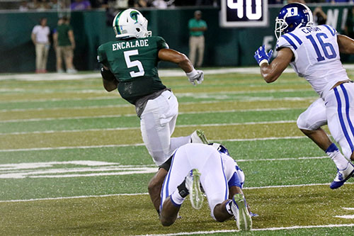 Tulane wide receiver Terren Encalade jukes a would-be tackler in the season opening game against Duke. (Zach Brien, UptownMessenger.com)