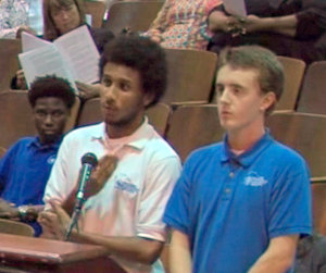 Students Casey Diehl and Miles Jordan address the Orleans Parish School Board on behalf of Sci High. (image via opsb.us)