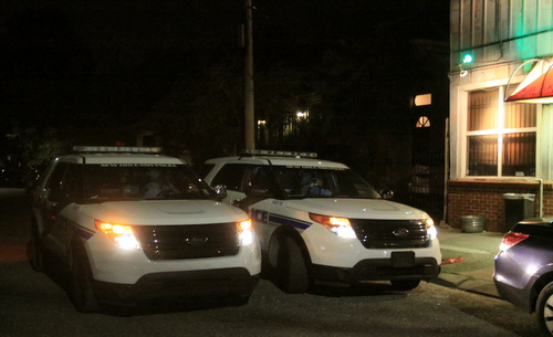 Two NOPD patrol units confer on Milan Street after speaking to witnesses near the Milan Lounge. (Robert Morris, UptownMessenger.com)