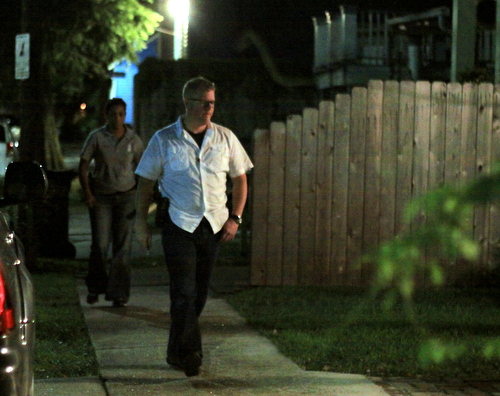 New Orleans Police detectives search the Dublin Street sidewalks for evidence after a woman was robbed in a nearby driveway. (Robert Morris, UptownMessenger.com)