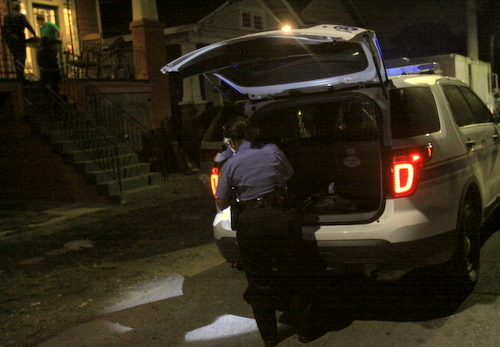 Police investigate a robbery in the 4500 block of Annunciation Street. (Robert Morris, UptownMessenger.com)