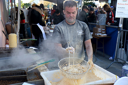 Jonathan Epperman of Parkway Bakery prepares oysters for the deep fryer. Parkway was one of 34 food vendors at the 2015 Oak Street Po boy Festival. (Zach Brien, UptownMessenger.com)