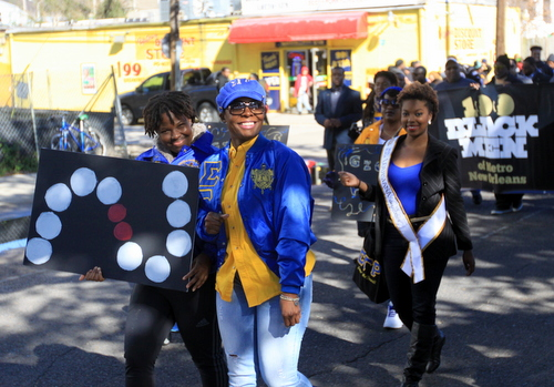 Sisters from the Sigma Gamma Rho sorority march through Central City. (Robert Morris, UptownMessenger.com)