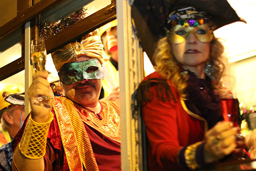 Masked members of the Phunny Phorty Phellows embark on their annual ride from the Willow street barn down the St. Charles avenue streetcar line. The event takes place on 12th night, 12 days after Christmas and is the first parade of Carnival season in New Orleans. (Zach Brien, UptownMessenger.com)