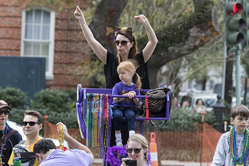 Rachelle Biondonlillo and Alla McKibben cheer for beads during the Krewe of Pontchartrain. The Krewe was one of five parades rolling Uptown on Saturday. (Zach Brien, UptownMessenger.com)