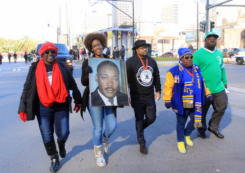 Marchers carry a portrait of Dr. Martin Luther King Jr. at the front of the parade on Loyola Avenue. (Robert Morris, UptownMessenger.com)