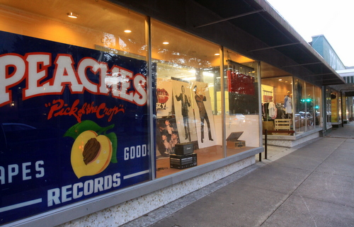 Peaches' massive sign fills the window at its temporary location next door to Top Drawer Antiques on Magazine Street. (Robert Morris, UptownMessenger.com)