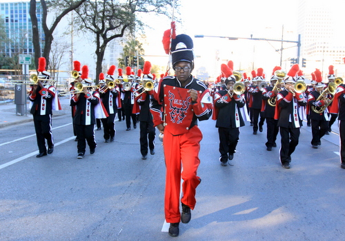The Martin Luther King Charter School band marches on Loyola Avenue. (Robert Morris, UptownMessenger.com)