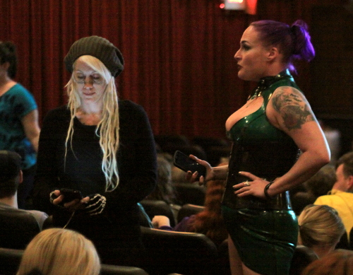 Two Bowie fans, Felina Dolly and Mistress Genevieve, wait for friends to arrive in their seats at the Prytania. (Robert Morris, UptownMessenger.com)