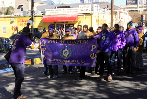 U.S. Rep. Cedric Richmond poses for a photo with a fraternity marching in the parade. (Robert Morris, UptownMessenger.com)