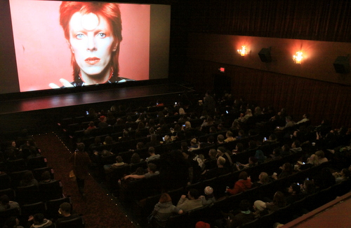In his Aladdin Sane persona, an image of David Bowie looms over the full house at Prytania Theatre. (Robert Morris, UptownMessenger.com)