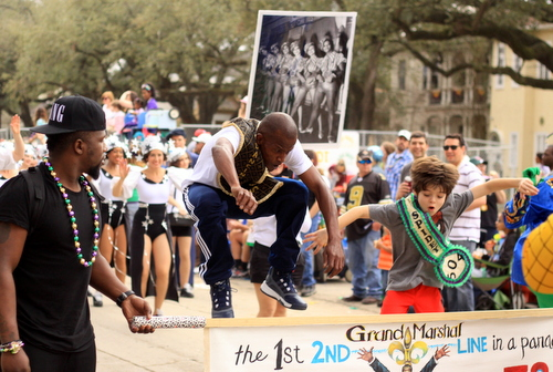 """Darryl """"Dancing Man 504"""" Young and """"Spidey 504"""" leap into the air at the head of the Krewe of Freret parade on Napoleon Avenue. (Robert Morris, UptownMessenger.com)"""