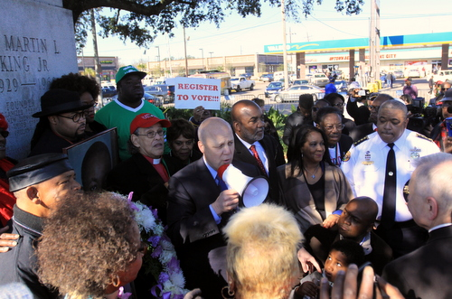 Mayor Mitch Landrieu describes the need for cooperation to move the city of New Orleans forward as he closes out the march at the Martin Luther King Jr. statue on South Claiborne Avenue. (Robert Morris, UptownMessenger.com)