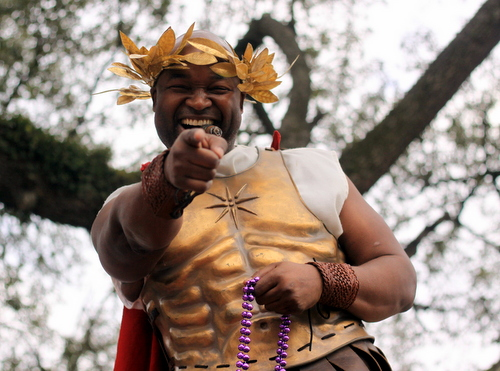 City Councilman Jason Williams rides the Krewe of Freret parade on Napoleon Avenue. (Robert Morris, UptownMessenger.com)
