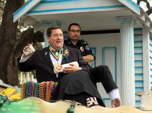 Lt. Gov. Billy Nungesser throws cups from his float in the Krewe of Choctaw parade on Napoleon Avenue. (Robert Morris, UptownMessenger.com)
