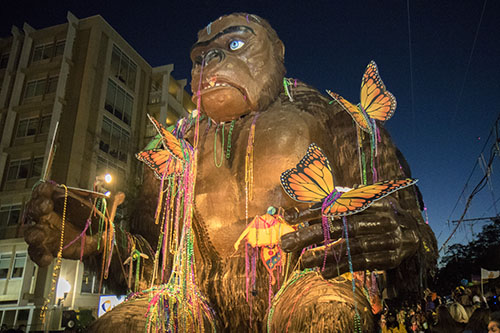 """Bacchus' King Kong float, which attendees throw beads at, leads the parade down St. Charles avenue. Bacchus 2016 rolled with the theme """"Flights of Delight."""" (Zach Brien, UptownMessenger.com)"""