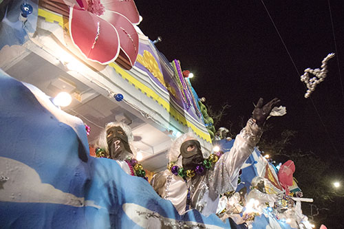 """A rider on Bacchus' """"Pegasus: The Winged Steed"""" throws beads into the crowd. Bacchus 2016 rolled with the theme """"Flights of Delight."""" (Zach Brien, UptownMessenger.com)"""