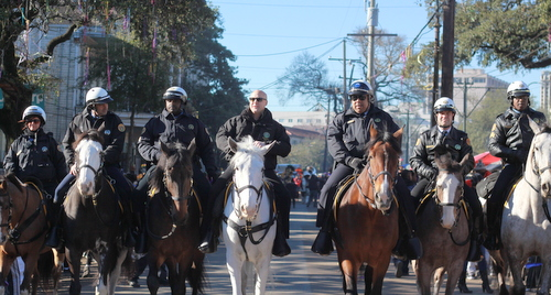 Mayor Mitch Landrieu, NOPD Superintendent Michael Harrison and other police officers ride on horseback in front of the Krewe of Zulu parade on Mardi Gras day, Feb. 9, 2016. (Robert Morris, UptownMessenger.com)