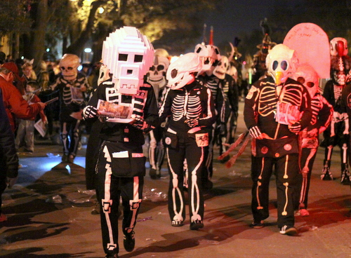 The Skeleton Krewe hands out newspapers as Le Krewe d'Etat rolls on Napoleon Avenue. (Robert Morris, UptownMessenger.com)