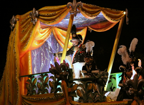 The Dictator, Richard XX, greets the crowd as Le Krewe d'Etat rolls on Napoleon Avenue. (Robert Morris, UptownMessenger.com)