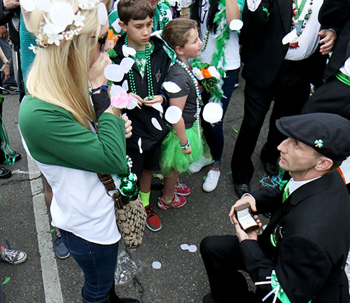 Brian McGing, right, proposes to Hillary Eyster, left, during the 66th annual Irish Channel St. Patrick's Day Parade on Saturday, March 12.  (Zach Brien, UptownMessenger.com)