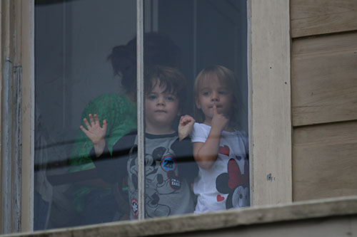Children watch the 66th annual Irish Channel St. Patrick's Day Parade from a balcony window on Magazine street on Saturday, March 12.  (Zach Brien, UptownMessenger.com)