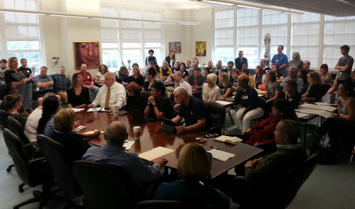 The Lusher Charter School board was surrounded by teachers and others to hear about the union issue on April 16. A similar crowd filled the board's meeting room on Saturday, May 21. (UptownMessenger.com file photo by Robert Morris)