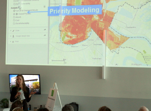 Holly Elwell of the Trust for Public Land describes the Climate-Smart Cities initiative at the Propeller entrepreneurship incubator on Monday, April 25. (Robert Morris, UptownMessenger.com)