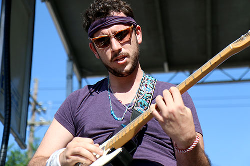 Robert Hinson of Sexual Thunder solos on his guitar at the Loyola University stage at the 2016 Freret Street Festival. The event featured 18 artists on three stages, 35 food vendors and craft vendors ranging from Freret and Soniat to Napoleon Avenue. (Zach Brien, UptownMessenger.com)