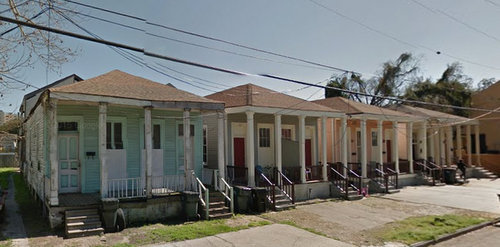 At left, 2112 Oretha Castle Haley Boulevard and the three identical shotgun homes next to it. (2014 image via Google)