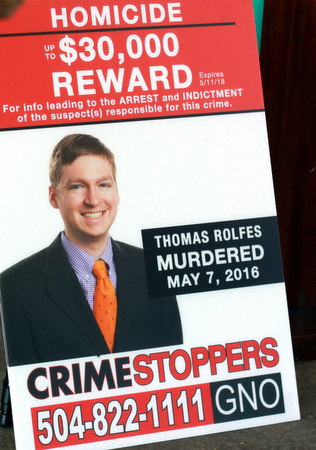 A poster announces the $30,000 reward for information relating to the May 7 shooting death of Thomas Rolfes. (Robert Morris, UptownMessenger.com)