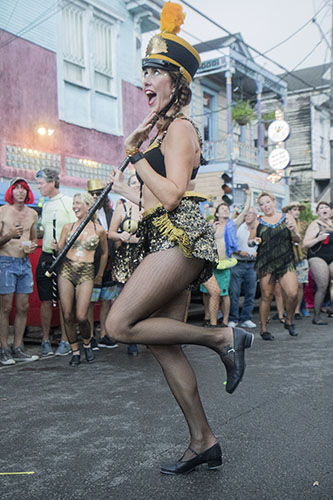 """Ali Timberlake, of Tap Dat, performs outside of the Maple Leaf Bar before the parade begins. The Krewe of O.A.K. celebrated the 30th anniversary of Mid Summer Mardi Gras with the theme """"Get Wet"""". (Zach Brien, UptownMessenger.com)"""